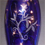 Lighted Blue Vase with Flowers